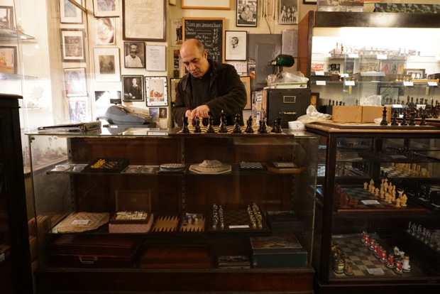 Imad Khachan behind the counter of his West Village chess shop. Khachan opened the Chess Forum in 1995 after a bitter feud with his business mentor.  Photo credit: Neil Giardino