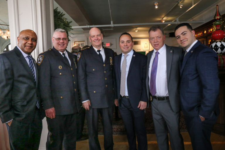 Chief of Department Terrence A. Monahan, the luncheon's keynote speaker, third from left, with members of Greenwich Village's Sixth Precinct, from left, Detective Robert Jackson, Captain Robert O'Hare, Officer Evrim Can, Detective Jim Alberici and Officer Joe Safatle.