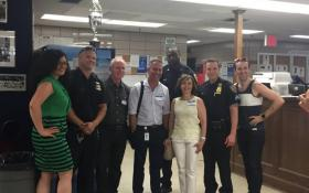 Greenwich Village-Chelsea Chamber of Commerce members posing for a photo with Sixth Precinct officers, including Maria Diaz, G.V.C.C. executive director, at far left; Ken Russo, fourth from left; Rocio Sanz, third from right; and Mathew Heggem, far right.
