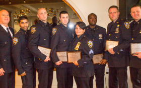 Photo by Zach Williams L to R: NYPD Officers Ravi Singh, Scott Williams, James Quirk, Sgt. Maggie Clamp, Officers Jackson Dagobert, Sean Malone and Gerard Collins were honored at The Greenwich Village-Chelsea Chamber of Commerce's 11th Annual Safe City, Safe Streets luncheon.