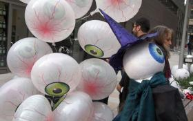 """I of the Beholder"" was the theme of the 2011 Greenwich Village Halloween Parade, inspired by French surrealist painter Odilon Redon's ""Eye Balloon"" —— hence the eyeball balloons. The 2012 parade was canceled in the wake of Superstorm Sandy."