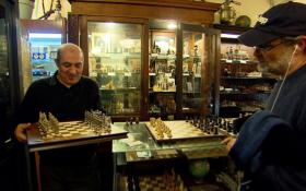 Imad Khachan shows a customer chess set. Sets range from $10 to $10,000. Photo credit: Russ Marhull