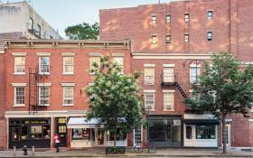 Four historic commercial storefronts on the corner of Bleecker and Christopher Streets in the West Village.